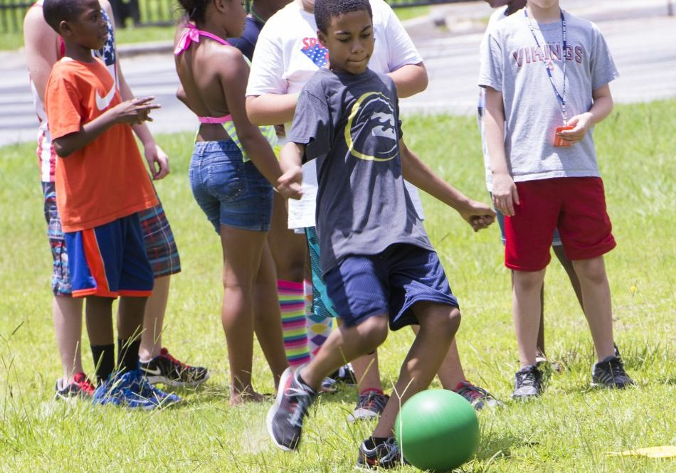 Group of Kids playing kickball