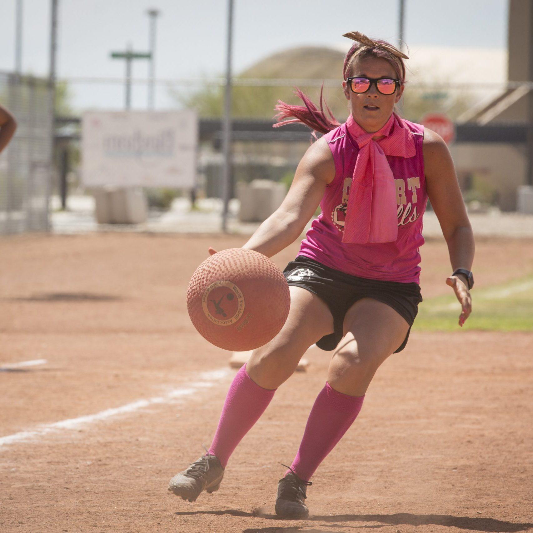 Woman catching a kickball